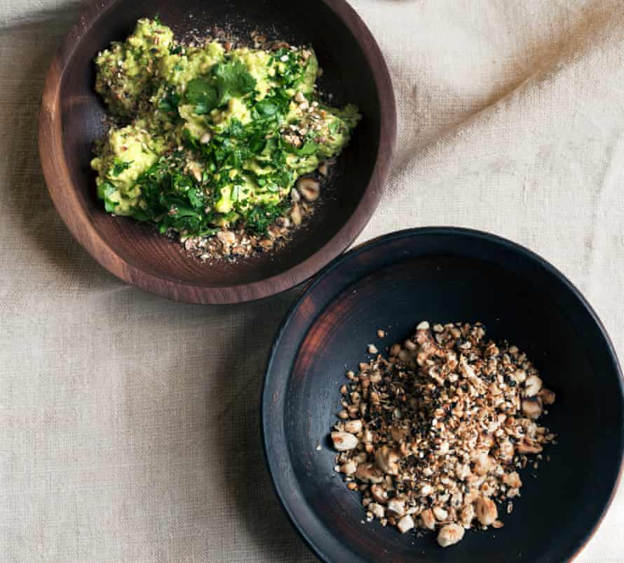 A bowl of hazelnut dukkah, and another bowl with the dukkah sprinkled over other food