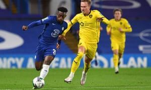Callum Hudson-Odoi (left) bursts away from Barnsley's striker Cauley Woodrow.