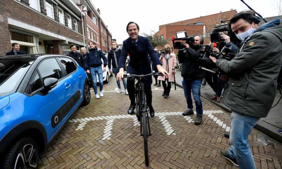 Mark Rutte on a bike in The Hague in March