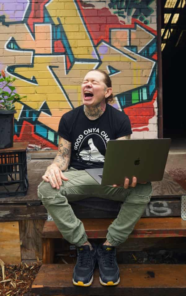 Nat with a laptop on his lap, looking like he's screaming
