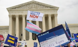 Demonstrators in favor of LGBT rights rally outside the US supreme court in Washington DC on 8 October 2019.
