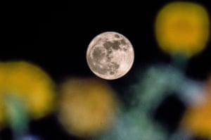 A full supermoon rises in Srinagar, the summer capital of Indian-administered Kashmir