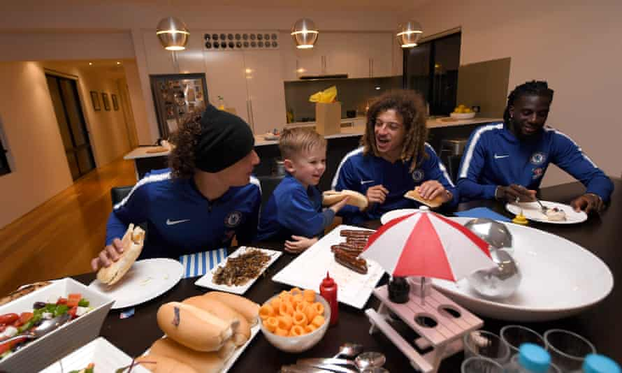 David Luiz, seen here enjoying a barbecue with Ethan Ampadu, Tiémoué Bakayoko and a young Australian fan, has responded well to life under Sarri.