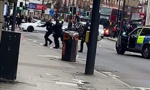 Armed police officers respond to the Streatham terrorist attack.