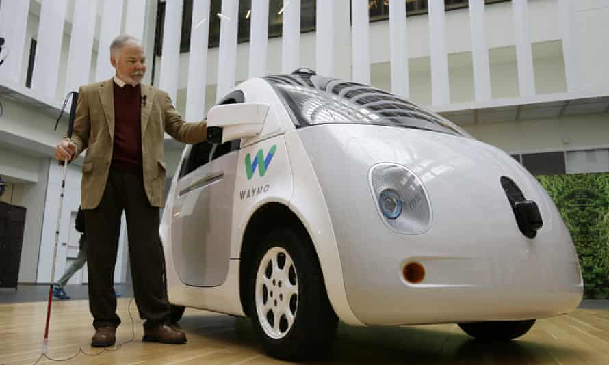 Steve Mahan, who is blind, stands by the Waymo driverless car during a Google event.