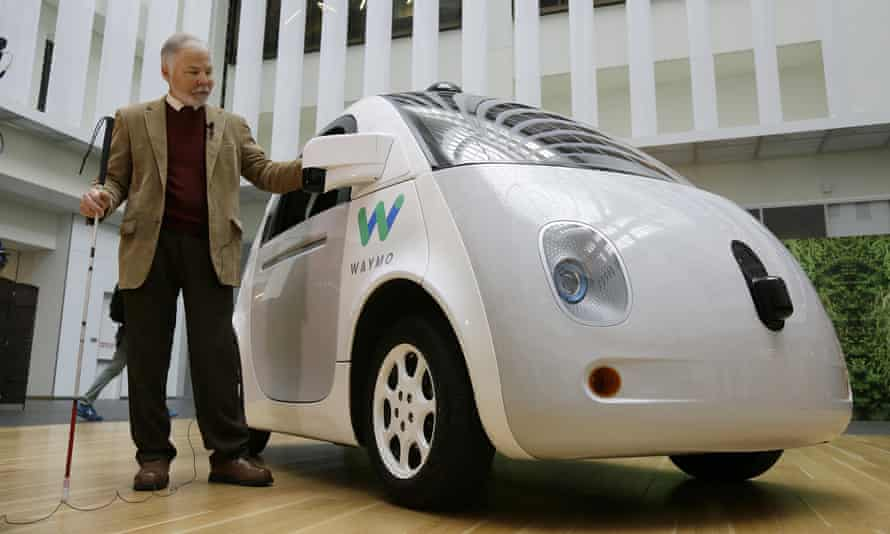 Steve Mahan, who is blind, stands by the Waymo driverless car during a Google event, Tuesday, Dec. 13, 2016, in San Francisco.