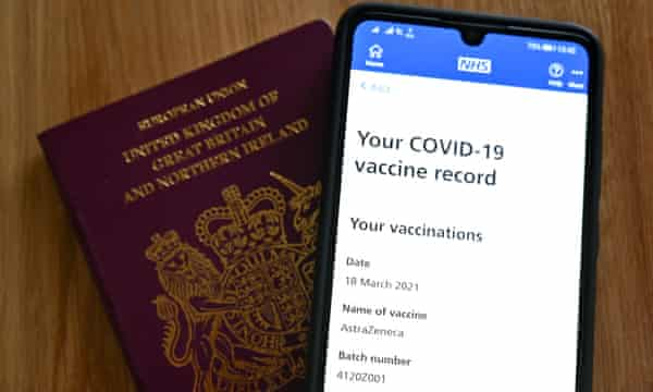 A smartphone screen displaying a Covid-19 vaccine record on the National Health Service (NHS) app