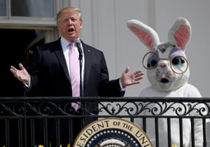 Washington DC, USPresident Donald Trump, accompanied by a person dressed as the Easter Bunny, welcomes guests with opening remarks during the 141st Easter Egg Roll on the South Lawn of the White House