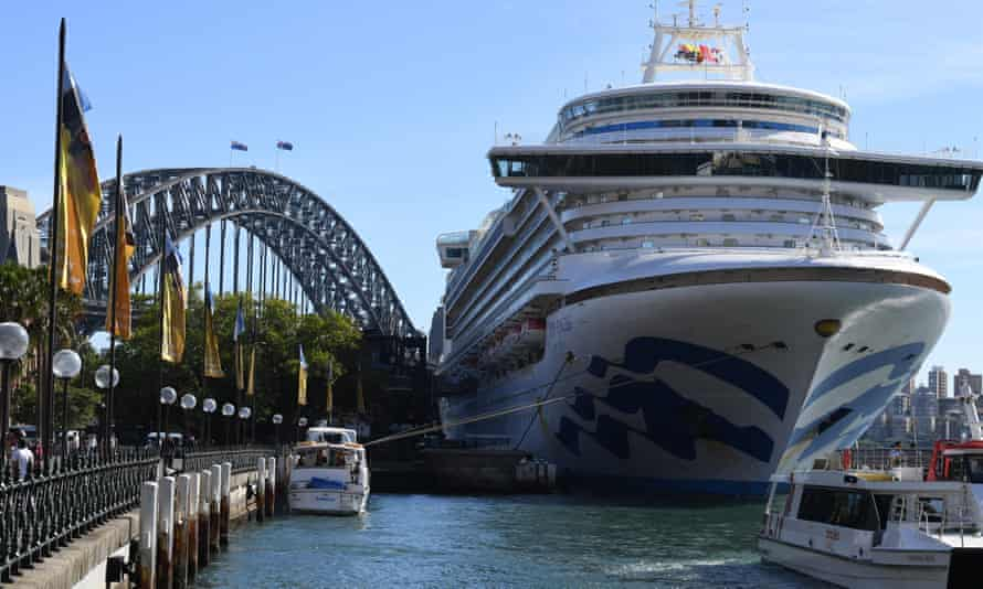 The Ruby Princess sits docked at Circular Quay in Sydney. Thousands of passengers have been told to self-isolate after three cases of coronavirus were confirmed onboard.