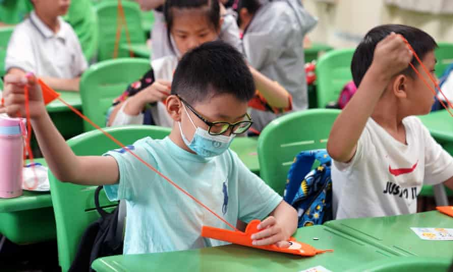 Children learning handicrafts at a school in Shanghai