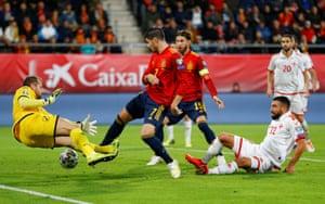 Alvaro Morata scores the opener in Cadiz.