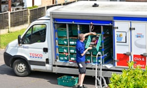 a tesco worker delivers food
