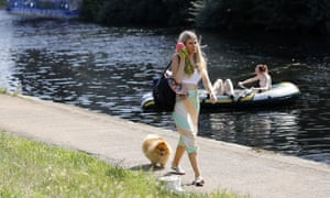 A woman walks with her dog near Queen Elizabeth Olympic Park in east London.