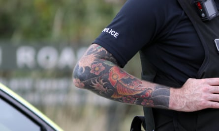 Police officer with tattooed arm