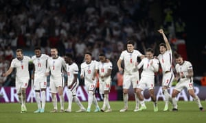 England players celebrate after England's goalkeeper Jordan Pickford saved a penalty.