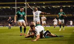 England's Manu Tuilagi celebrates as Henry Slade scores England's third try in opening-weekend victory over Ireland.