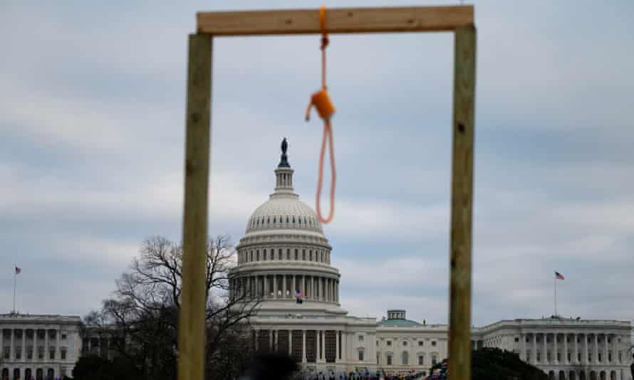 A noose is seen on makeshift gallows as supporters of Donald Trump gather outside the Capitol.