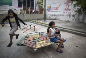 Children play in a park in a residential complex in Caracas