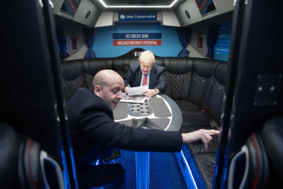 Boris Johnson and Lee Cain, director of communications, head to the Kent Event Centre, Maidstone, on 6 Decembe