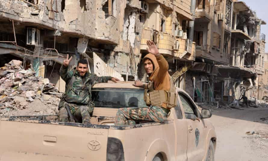 Syrian pro-government forces patrol in the eastern city of Deir Ezzor on 4 November, after taking the former Isis stronghold.