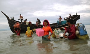 Rohingya Muslims flee from Myanmar's Rakhine state to Bangladesh by boat.