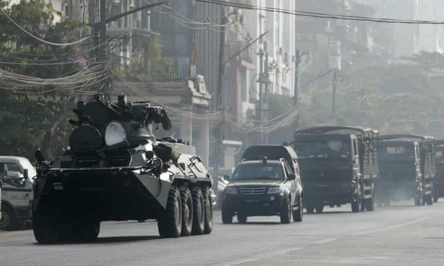 Armoured vehicles drive along a road in Yangon, Myanmar, 15 February 2021.