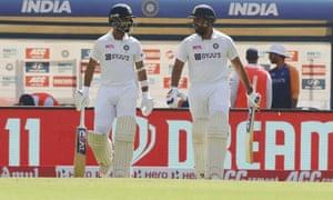 India's Rohit Sharma and Ajinkya Rahane take to the field.