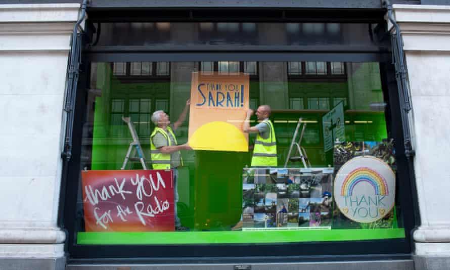 Workmen prepare the new thank-you window at Selfridges'Oxford Street store
