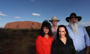 (L-R) Labor parliamentarians Malarndirri McCarthy, Warren Snowdon, Linda Burney and Pat Dodson at Uluru on Sunday evening. They have collectively criticised the prime minister for failing to show up to the Uluru climb closure celebrations.