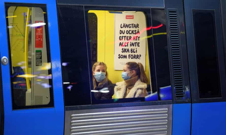 Passengers aboard an underground train in Stockholm, Sweden