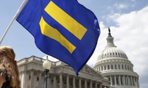 A supporter of LGBT rights holds up an 'equality flag' on Capitol Hill in Washington.