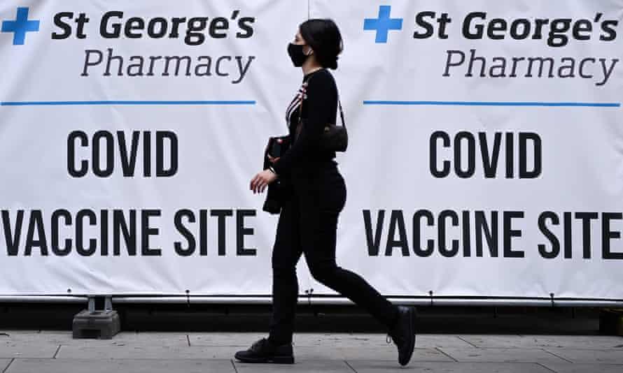 A pedestrian walks past a Covid vaccination centre in London.
