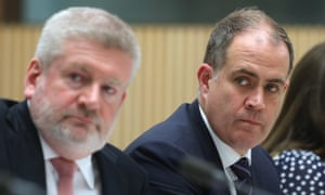 Communications minister Mitch Fifield sits beside the acting managing director of the ABC, David Anderson,