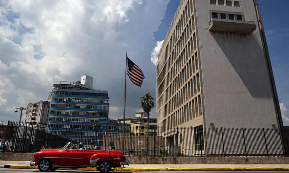 A classic car passes in front of the US embassy in Havana, Cuba, 16 June 2017, where diplomats suffered hearing loss and other symptoms