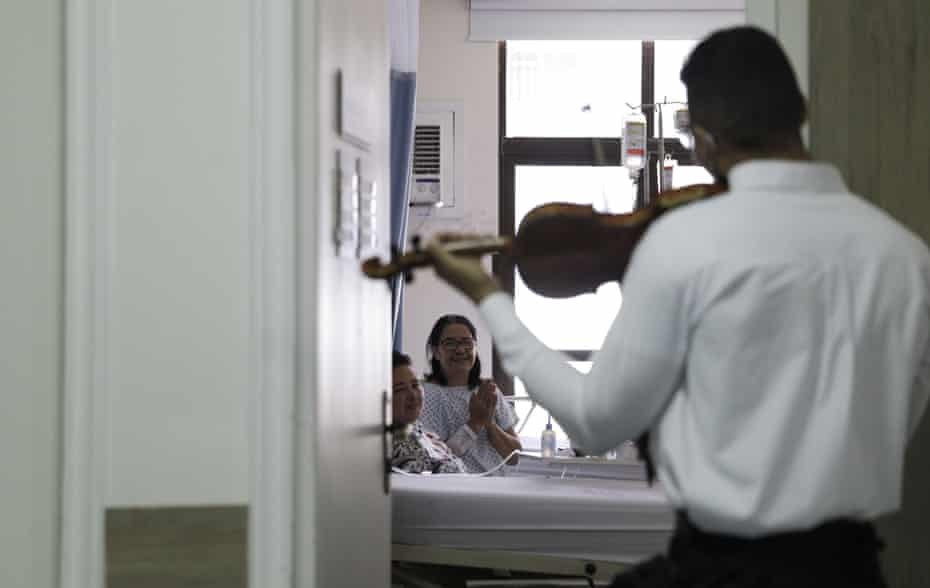 Cristiano de Andrade plays his violin for patients at Semiu hospital, as part of a project that brings music to healthcare workers, patients and relatives, as the spread of coronavirus ontinues, in Rio de Janeiro.
