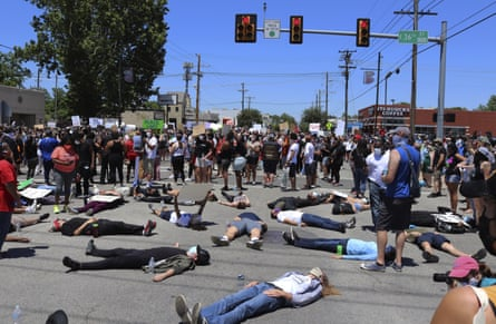 People lie down Peoria Avenue in Tulsa during a demonstration sparked by the death of George Floyd.