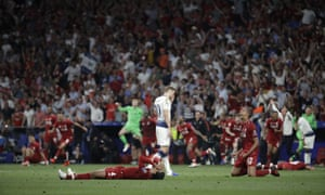 Liverpool's players celebrate after winning the Champions League final soccer match against Tottenham Hotspur at the Wanda Metropolitano Stadium in Madrid, 1 June