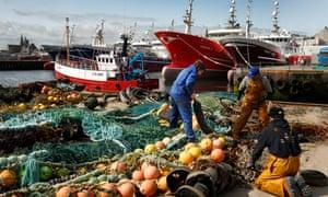 Fishermen prepare nets in Fraserburgh, Scotland