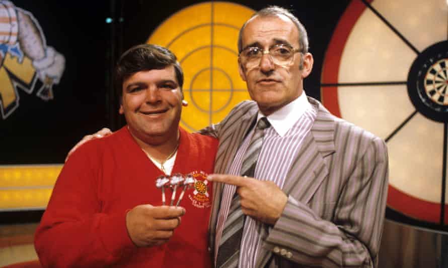 Jim Bowen with the darts star Jocky Wilson on Bullseye, 1984.