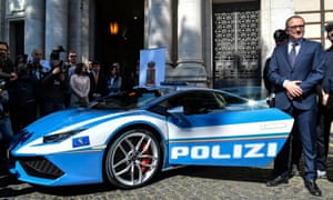 Lamborghini boss Stefano Domenicali next to the new police's car Lamborghini Huracan.