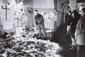 23 November 1989, 18:00: Czechs look at floral tributes left at Národní třída in central Prague, where peaceful demonstrators were beaten by police on 17 November