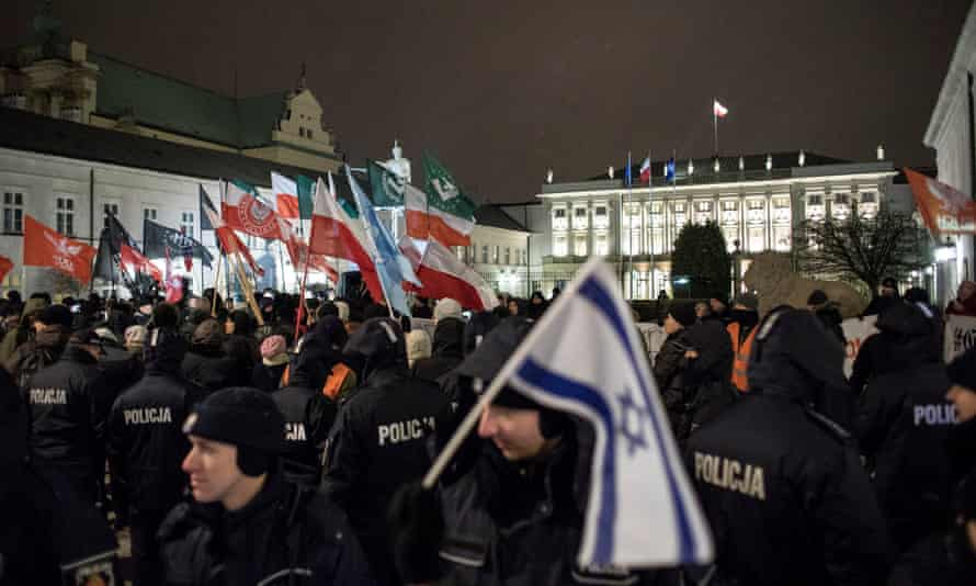Supporters of the far-right National Radical Camp (ONR) gather in support of the Holocaust bill in front of the presidential palace in Warsaw on 5 February.