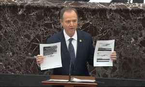 Adam Schiff holds redacted documents as he speaks during the impeachment trial against Donald Trump.