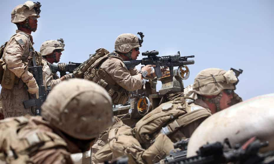 Marines pick out enemy targets as they receive incoming fire in Main Poshteh, Afghanistan.