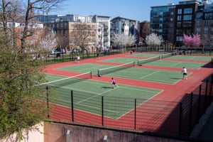 Tanner Street tennis courts in Bermondsey, south-east London, are busy in Monday's beautiful spring weather