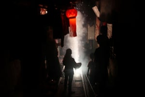 Firecrackers burn on a street in Mumbai, India