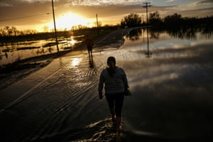 Gridley, USA Melissa Martinez and her son, Fernando walk through floodwater near the Feather River as it continues to swell from the water being let out of the Oroville Dam Spillway