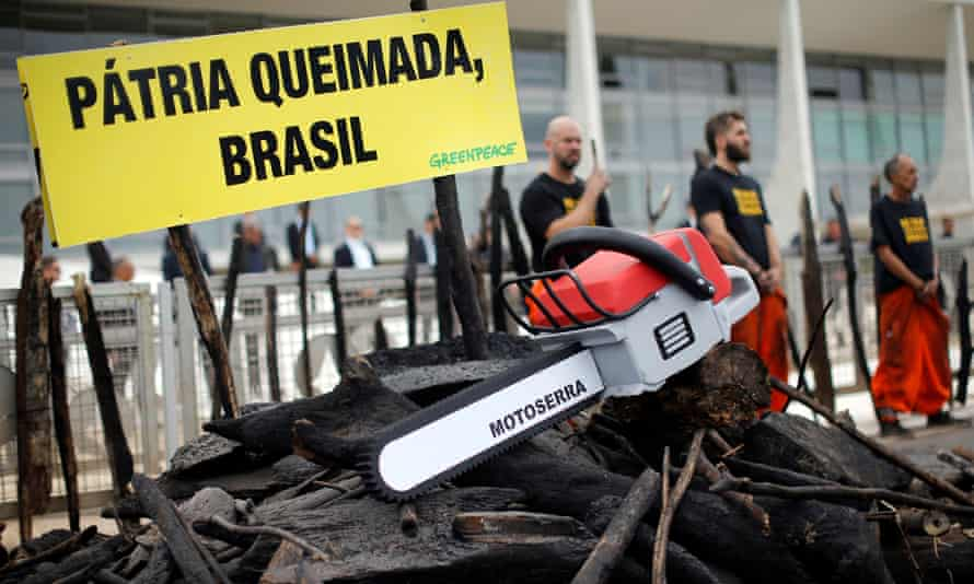 Greenpeace activists attend a protest against the government's environmental policies, the oil spill in north-eastern states and the environmental situation in the Amazon, in Brasília, Brazil, on 23 October.