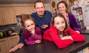 'We'd save at least £1,000 a year if the council created a week's holiday at an off-peak time': Rob and Sarah Ryman, with their children, Daisy, 10, and Hunny, five.