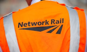 A person wearing a Network Rail jacket